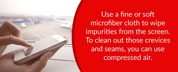 Use a microfiber cloth or compressed air to clean phone impurities